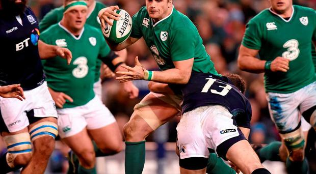 Ireland's Jamie Heaslip is tackled by Scotland's Duncan Taylor. Photo: Stephen McCarthy / Sportsfile