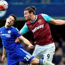Chelsea's Cesar Azpilicueta in an aerial battle with West Ham's Andy Carroll. Photo: Hannah McKay/Reuters
