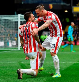 Stoke City's Joselu celebrates scoring his side's second goal of the game with teammate Marko Arnautovic. Photo: Daniel Hambury/PA Wire.