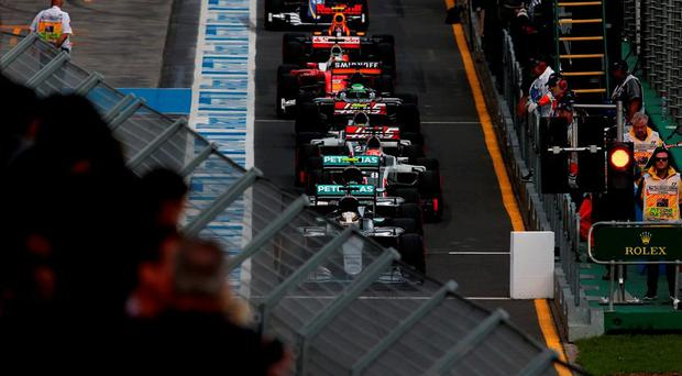 Lewis Hamilton leads out the the rest of the grid in the pitlane at the start of yesterday morning's qualifying for the Australian Grand Prix at Albert Park in Melbourne. Photo: Lars Baron