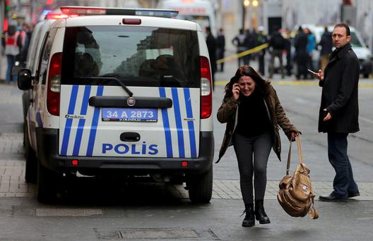 SHOCK: A woman reacts following the suicide bombing in tourist district in central Istanbul. Photo: Reuters