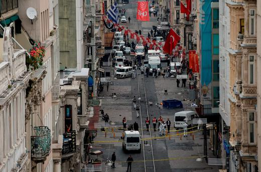 Emergency services inspect the area following a suicide bombing in a major shopping and tourist district in central Istanbul. Photo: Getty Images