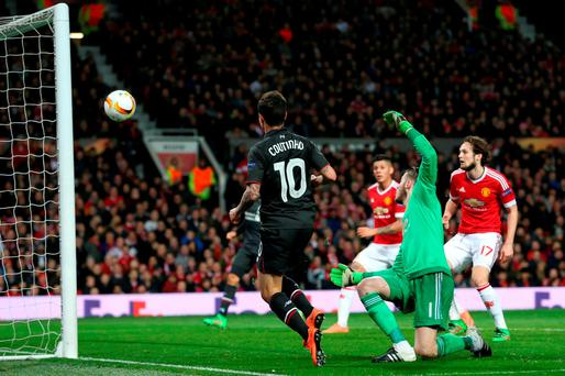 Liverpool's Philippe Coutinho scores his crucial goal against Manchester United in the Europa League
