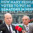 HOW DID THAT ONE WORK OUT? Minister for Finance Michael Noonan, and Minister for Jobs, Enterprise and Innovation Richard Bruton, on Merrion Square, Dublin, in September 2013, during a Fine Gael unveiling of an online and mobile ad campaign inviting the public to guess how many people voted to elect the then Seanad. Photo: Gareth Chaney/Collins