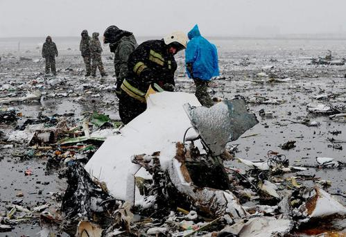 TRAGEDY: Investigators examine the wreckage