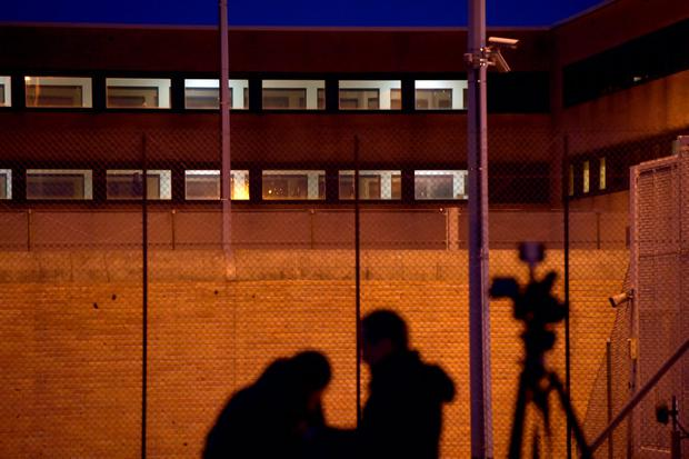Reporters stand in front of a prison in Bruges where Salah Abdeslam is being held, Belgium, March 19, 2016. Salah Abdeslam, the most-wanted fugitive from November's Paris attacks, was arrested after a shootout with police in Brussels on Friday