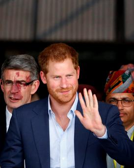 Britain's Prince Harry waves upon his arrival at Tribhuvan International Airport in Kathmandu, Nepal, March 19, 2016