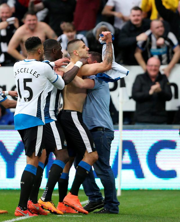 Mitrovic celebrates after scoring the first goal for Newcastle