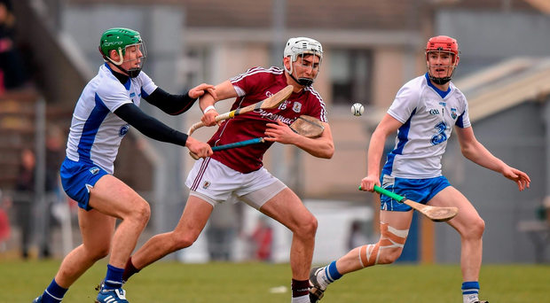 Jason Flynn, Galway, is tackled by Tom Devine, Waterford