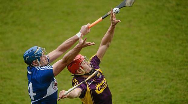 20 March 2016; Lee Chin, Wexford, in action againt Willie Hyland, Laois. Allianz Hurling League, Division 1BA, Round 5, Laois v Wexford, O'Moore Park, Portlaoise, Co. Laois. Picture credit: Piaras Ó Mídheach / SPORTSFILE