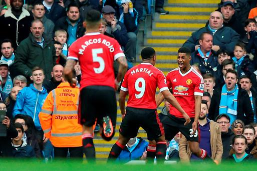 Manchester United's Marcus Rashford (right) celebrates scoring