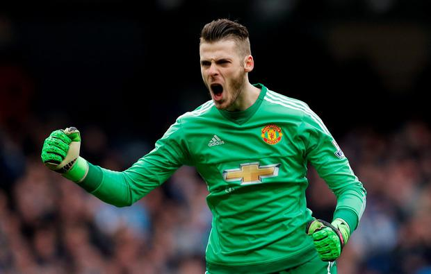 David de Gea celebrates after Marcus Rashford scored the first goal for Manchester United