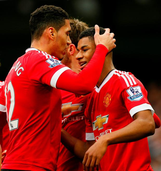 Marcus Rashford celebrates with team mates after scoring the first goal for Manchester United