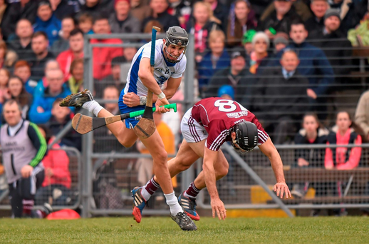 Waterford's Maurice Shanahan is tackled by Galway's David Collins at Walsh Park. Photo: Sportsfile