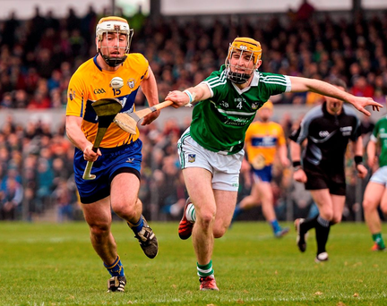 Clare's Conor McGrath attempts to get away from Richie English of Limerick during their Allianz NHL Division 1B clash in Cusack Park Photo: Diarmuid Greene / SPORTSFILE