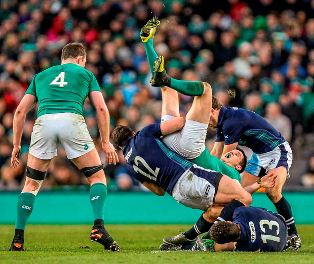 Johnny Sexton is tip-tackled by Scotland's Alex Dunbar. Photo: Sportsfile