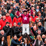 Owner Michael O'Leary (far left), jockey Bryan Cooper and trainer Gordon Elliott all raise their arms in triumph as Don Cossack is led back into the winner's enclosure at Cheltenham on Friday Photo: Cody Glenn / SPORTSFILE