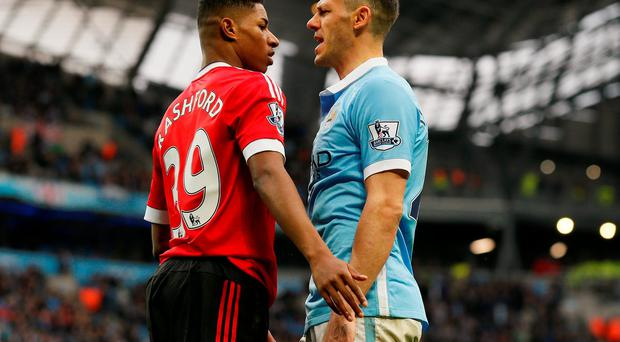 Manchester City's Martin Demichelis clashes with Manchester United's Marcus Rashford. Photo: Reuters