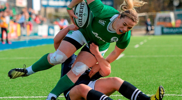 Niamh Briggs shows her determination as she tries to escape the clutches of Scotland's Lisa Martin Photo: Seb Daly / SPORTSFILE