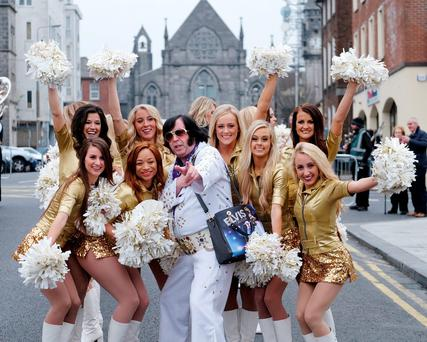 An Elvis impersonator with the Golden Girls of University of Missouri marching band at the 46th International Band Championship parade in Limerick City. Photo: Don Moloney/Press 22