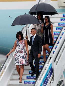 US president Barack Obama, his wife Michelle, and their daughters Malia and Sasha, exit Air Force One. Photo: Reuters