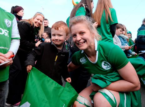 Young rugby fan Zach O'Riordan (5), from Portmarnock, Co Dublin, meets Irish player Claire Molloy after the Six Nations match versus Scotland. Picture: Caroline Quinn