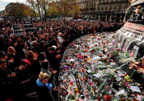 Crowds gather to pay a silent tribute to the victims of the terror attacks at the Place de la Republique, in Paris. Photo: Christopher Furlong/Getty Images
