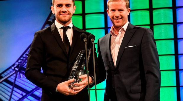 Republic of Ireland's Robbie Brady is presented with the 3 FAI International Young player of the year Award by Gavin McAllister , PR & Sponsorship Manager at Three Ireland. 3 FAI International Soccer Awards. RTE, Donnybrook, Dublin. Picture credit: David Maher / SPORTSFILE