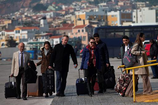 Turkish delegation of observers gets to the port of Mytilini, on Greek island of Lesbos. (AP Photo/Petros Giannakouris)