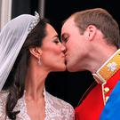 Prince William and his wife Kate Middleton, Duchess of Cambridge, kiss on the balcony of Buckingham Palace in London, following their wedding on April 29, 2011