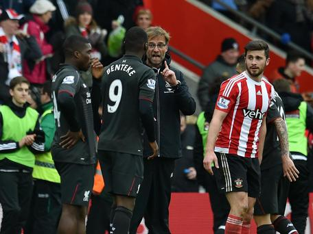 Jurgen Klopp and Christian Benteke discuss the Belgian's performance at Southampton. Getty