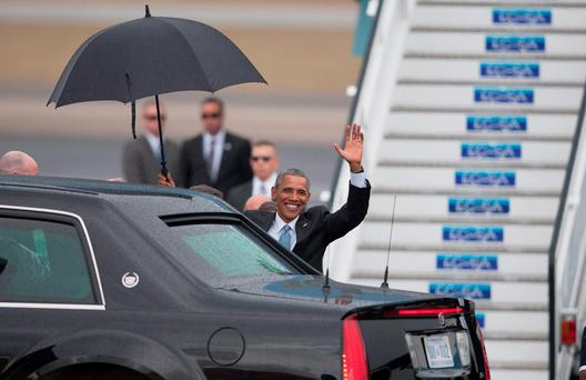 President Barack Obama waves upon arrival to Jose Marti International Airport in Havana, Cuba, Sunday, March 20, 2016.(AP Photo/Fernando Medina)