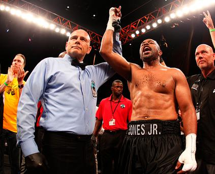 MASHANTUCKET, CT - AUGUST 16: Roy Jones Jr. has his arm raised by referee Danny Schiavone after knocking Eric Watkins out during the sixth round of their bout in the season two finale of NUVOtvÕs Knockout at Foxwoods Resort Casino on August 16, 2015 in Mashantucket, Connecticut. Jones won by a knockout in the sixth round. (Rich Schultz/Getty Images for NUVOtv)