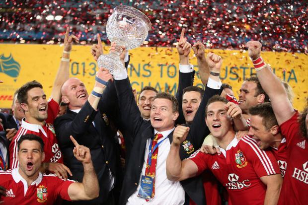 SYDNEY, AUSTRALIA - JULY 06: Brian O'Driscoll (R) and Paul O'Connell of the Lions raise Tom Richards Cup after their victory during the International Test match between the Australian Wallabies and British & Irish Lions at ANZ Stadium on July 6, 2013 in Sydney, Australia. (Photo by David Rogers/Getty Images)