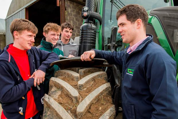Checking out the new Fendt tractor at the Teagasc careers open day in Clonakilty Agricultural College are twins Cathal and Sean O'Sullivan, Mitchelstown, Rory Crowley, Ballinadee and Michael Kelly, machinery teacher. Photo O'Gorman Photography.