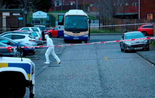 A police forensic officer at the scene of a shooting near a primary school in the Moyraverty area of Craigavon, Co Armagh Photo: Niall Carson/PA Wire
