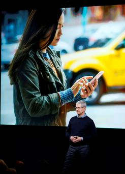 Apple CEO Tim Cook speaks during the unveiling of the new iPhone at Apple headquarters in Cupertino, California. REUTERS/Stephan Lam