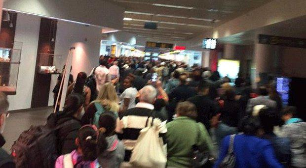 Passengers at Brussels Airport this morning