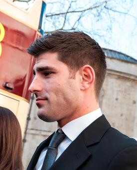 Footballer Ched Evans outside the High Court, London, where his conviction for raping a 19-year-old woman is to be reviewed by leading judges. Lauren Hurley/PA Wire