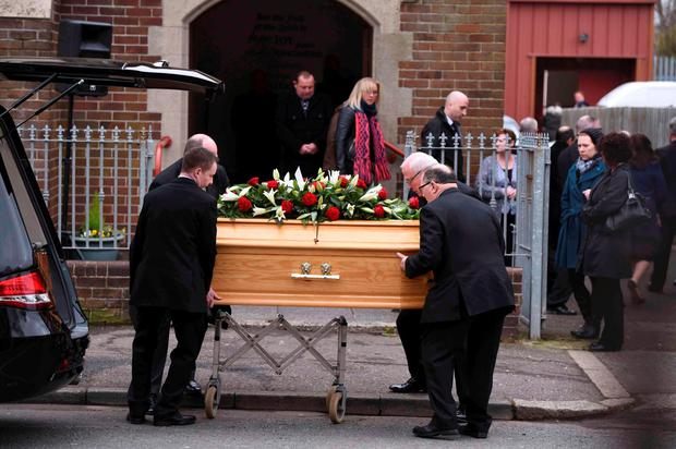 The coffin of prison officer Adrian Ismay is carried into Woodvale Methodist Church for his funeral service in Belfast, Northern Ireland March 22, 2016
