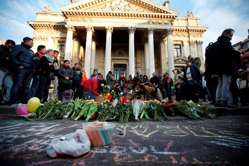 People gather around a memorial in Brussels following bomb attacks in Brussels, Belgium. Reuters/Charles Platiau