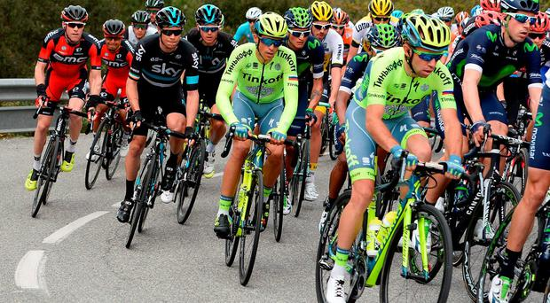 Nicolas Roche, second left, tracks Alberto Contador during yesterday's second stage of the Volta a Catalunya. Photo: Josep Lago/AFP/Getty Images