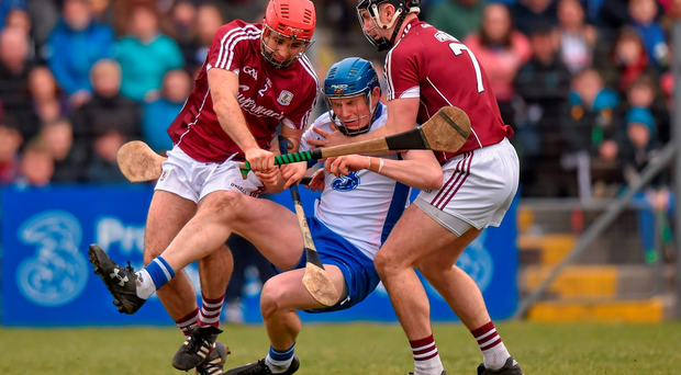 Despite the best efforts of Galway's Paul Hoban, left, and Aidan Harte, seen here tackling Austin Gleeson of Waterford at Walsh Park on Sunday, the Tribesmen are facing a play-off after finishing fifth in Division 1A. Photo: Ramsey Cardy/Sportsfile