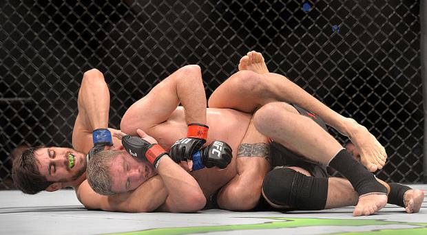 BRISBANE, AUSTRALIA - MARCH 20: Antonio Carlos Junior and Daniel Kelly get into the grapple during their UFC Middleweight Bout at UFC Brisbane on March 20, 2016 in Brisbane, Australia. (Photo by Bradley Kanaris/Getty Images)