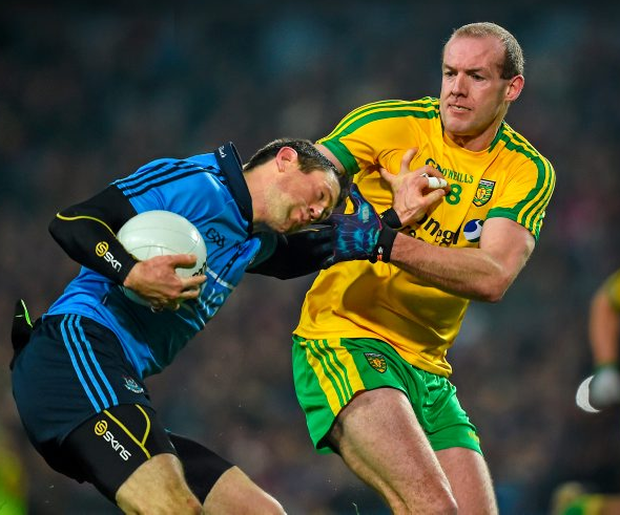 Dublin's Denis Bastick tries to hold off Donegal's Neil Gallagher in last year's Allianz FL Division 1 clash in Croke Park. Photo: Ray McManus/Sportsfile