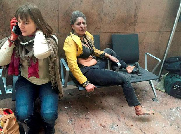 Injured people are seen at the scene of explosions at Zaventem airport. REUTERS