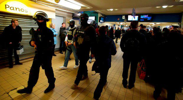 Soldiers and policemen patrol at Brussels' North station, on March 23 2016, one day after the attacks on Brussels airport and at a metro station