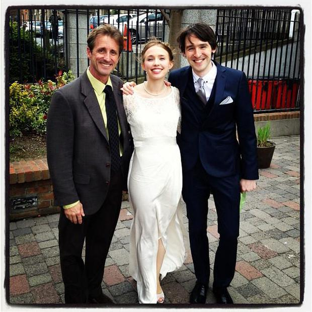 Rashel Winn pictured with her father Eric (right) and her husband Seamus on her wedding day