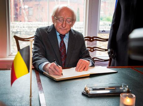 President Michael D Higgins signs the book of condolances at The Belgian Embassy, Ballsbridge today.Picture: Colin O'Riordan