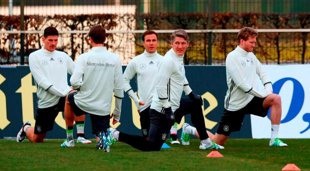Bastian Schweinsteiger (FRONT) of Germany and his team mates look on during a Germany training session ahead of their International friendly match against England on Saturday